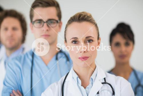 Doctor with colleagues in hospital