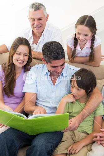 Multigeneration family reading book