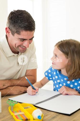 Father looking at daughter drawing