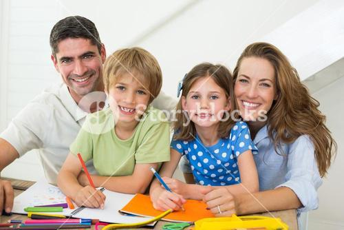 Parents with children drawing at home