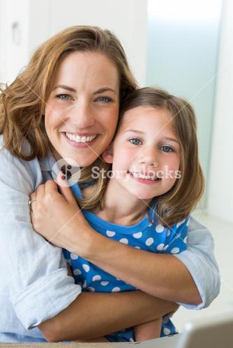 Loving mother embracing daughter