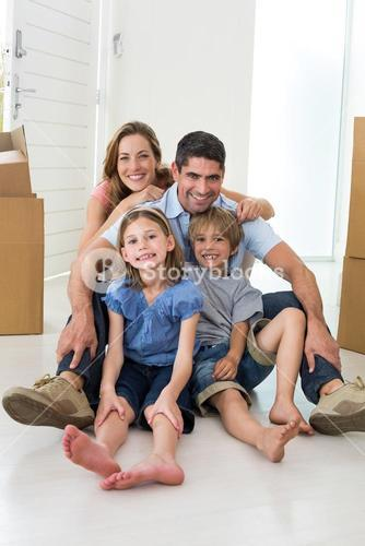 Family sitting on floor in new house