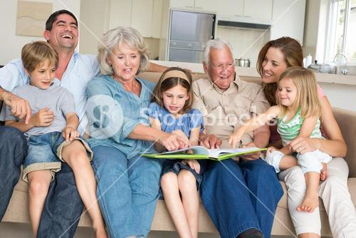 Family reading storybook at home