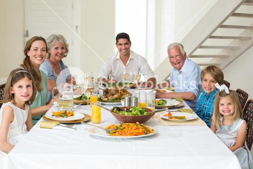Family having meal together at dining table