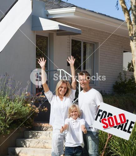 Delighted family buying a house