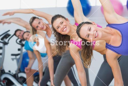 People doing power fitness exercise in fitness studio