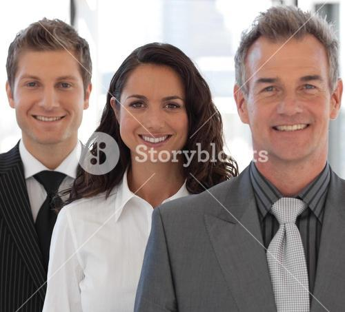 Happy Business team looking at camera