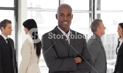 Smiling business leader in front of team