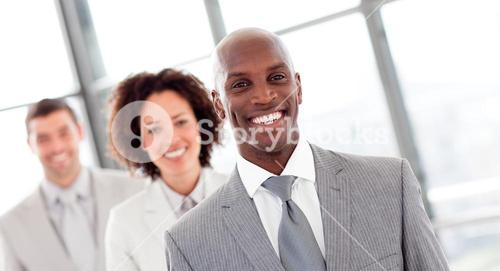 Smiling businessman in a row