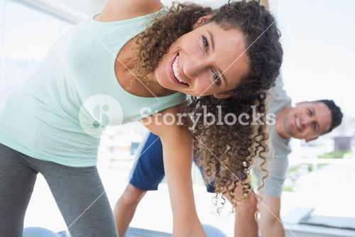 Woman stretching in exercise room