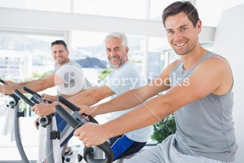 Men on exercise bikes