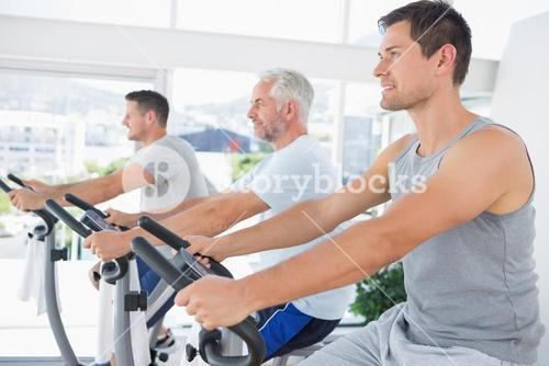 Men working out on exercise machines