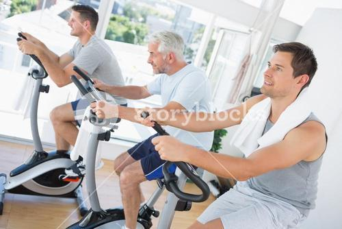 Men exercising on fitness bikes
