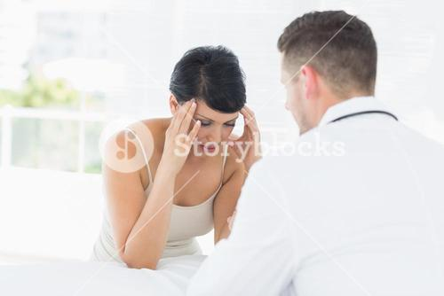 Stressed woman visiting doctor