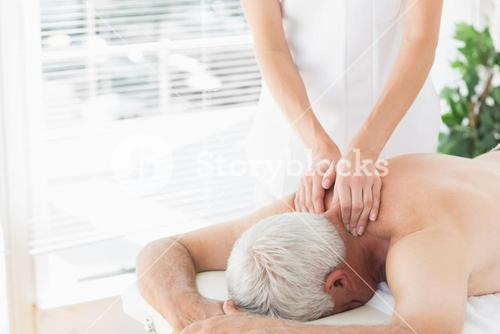 Senior man getting back massage