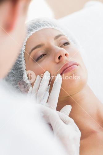 Woman recieving botox injection in upper lip