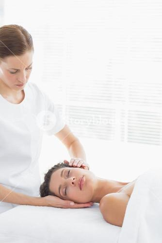 Physical therapist massaging woman
