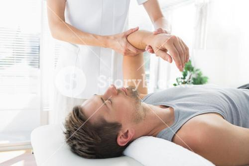 Man receiving hand massage from therapist