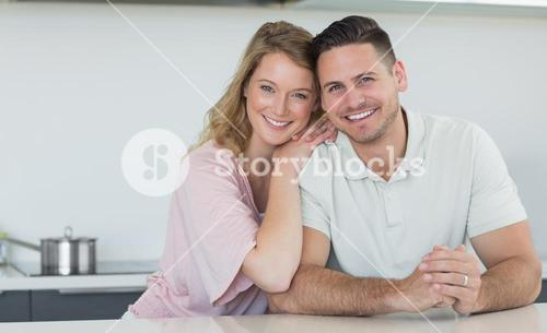 Couple smiling at kitchen counter