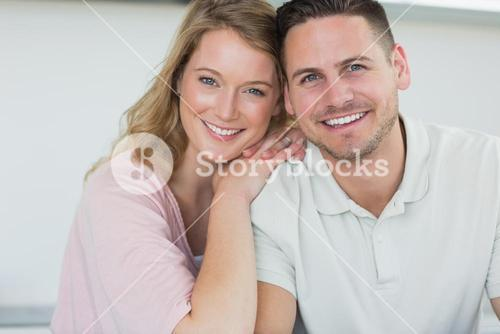 Couple smiling in kitchen