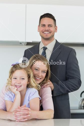 Family smiling together at table