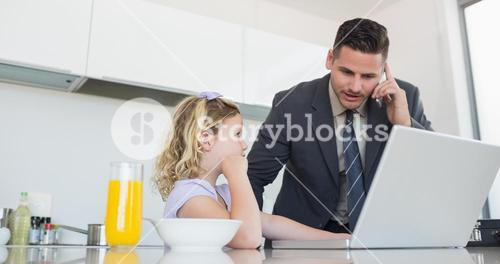 Daughter looking at father on call using laptop