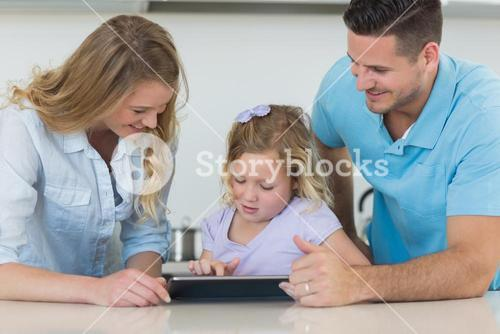 Family using tablet PC at table