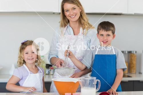 Family baking cookies at counter top