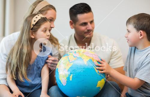 Family with globe in house