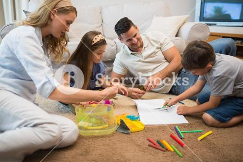 Family assisting boy in drawing