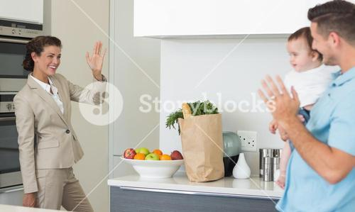 Businesswoman waving to family