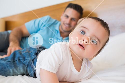Baby with father in bed