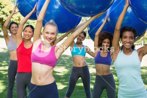 Group of women exercising with fitness balls