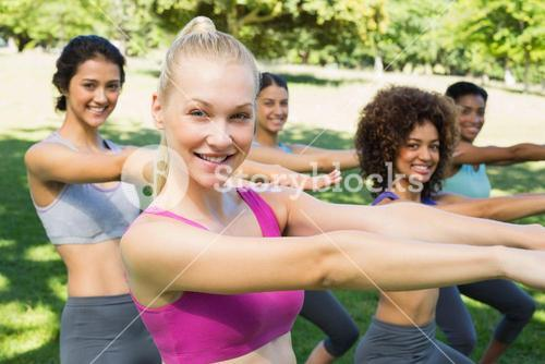 Multiethnic women stretching in park