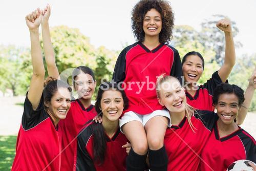Successful female soccer team at park