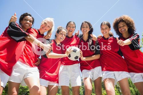 Soccer players gesturing thumbs up