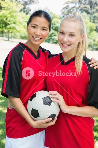 Confident multiethnic soccer players