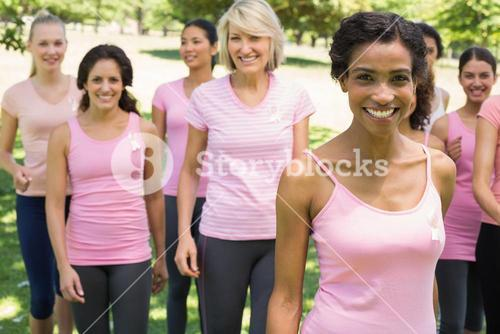 Women participating in breast cancer awareness at park