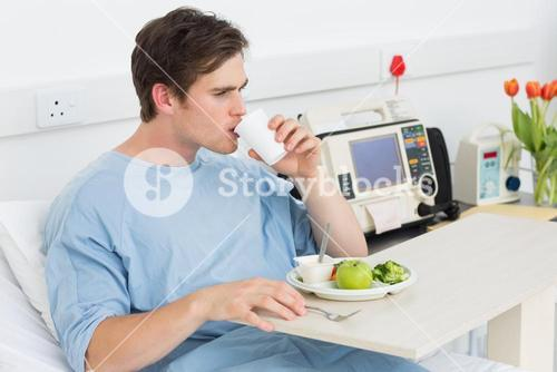 Patient drinking water while having meal