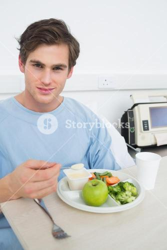 Patient eating healthy food in hospital