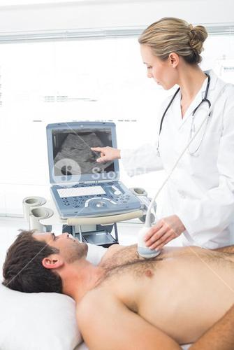 Doctor using sonogram on male patient
