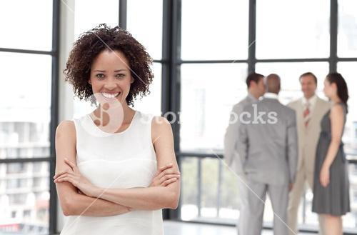 Lively businesswoman on phone in office with her team