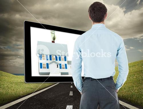 Composite image of businessman standing with hands in pockets