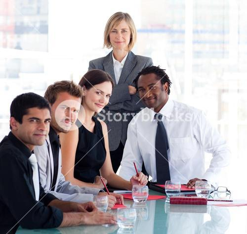 Female manager with her team looking at the camera