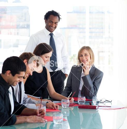Businessman training a group of students in business