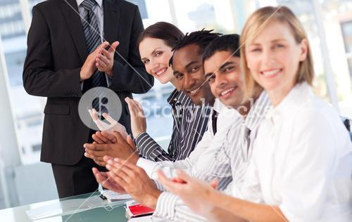 Business team clapping in a meeting