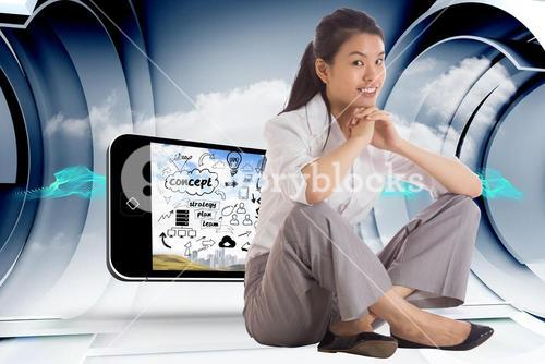 Composite image of smiling businesswoman sitting with hands together