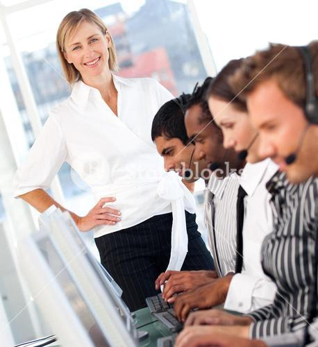 Radiant female leader with a team on a call center