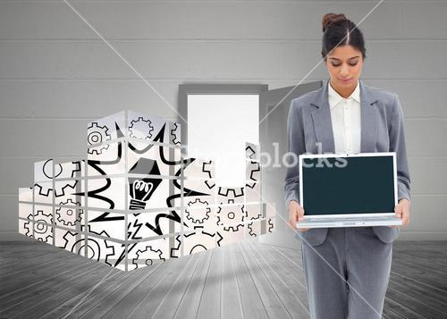 Composite image of businesswoman looking at laptop in her hands