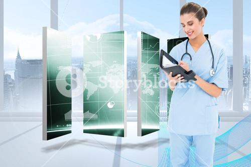 Composite image of attractive brown haired nurse in blue scrubs filling an agenda